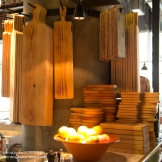 The many sizes of wooden planks used to serve antipasti.